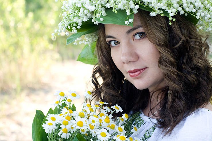Portrait of a young beautiful in traditional Ukrainian embroider