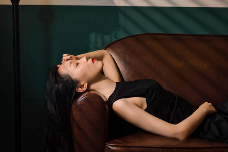 asian woman on the bed